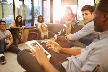 Group Of University Students Relaxing In Common Room