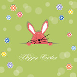 Easter bunny poking its head out of cut in paper poster