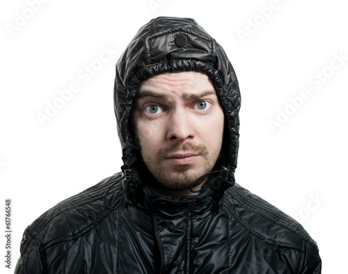 Guy with beard and black jacket with hood isolated on white.