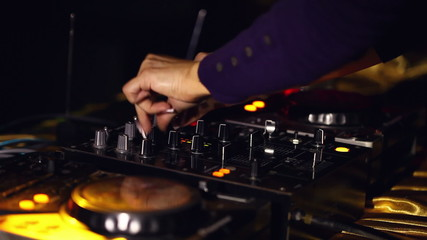 Hands of woman dj working with sound mixer
