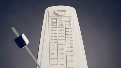 Close-up view of music metronome with moving pendulum, loop