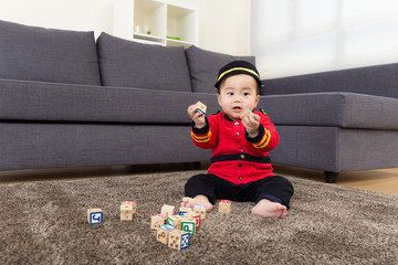 Baby playing with toys blcok