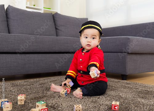 Little boy playing with toys block