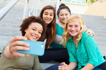 Female High School Students Taking Selfie Photograph