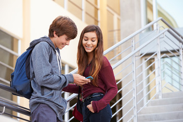 Two High School Students Standing Outside Building
