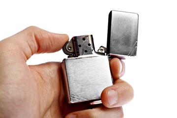Hand holding vintage lighter