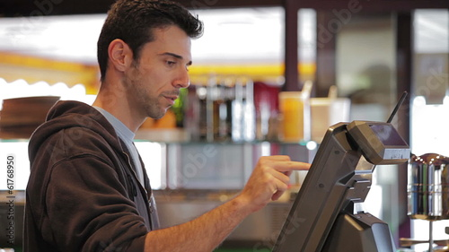 Man at cash register - close up