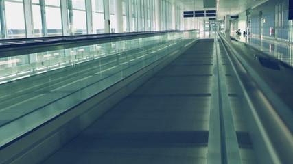 Camera moving on flat escalator at airport, HD 1080p