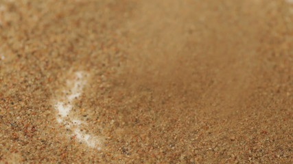 Sand sifting in a pile, close-up view, HD 1080p