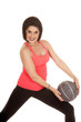 older woman medicine ball on knee.
