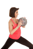 older woman medicine ball by chest side
