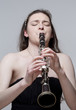 Young Female Musician Playing Clarinet