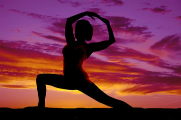 silhouette yoga woman lunge head between arms