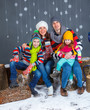 Funny family in winter clothes