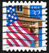 stamp printed in the USA shows United States Flag Over Porch
