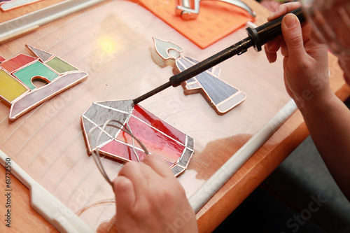 Stained glass maker works with red lamp souvenir
