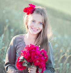 Portrait of a beautiful girl with red rose