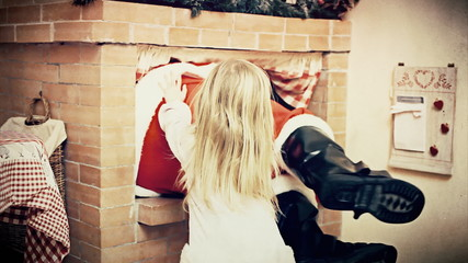 Christmas Eve little girl push Santa Claus in fireplace antique