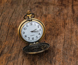 Vintage pocket watch  on wooden background