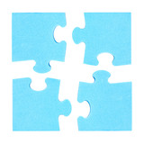Four  puzzle pieces combined cooperation concept