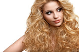 Blonde Hair. Portrait of Beautiful Woman with Long Curly Hair.