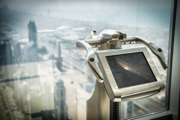 tourist digital binoculars in dubai skyscraper