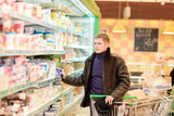young man shopping for groceries