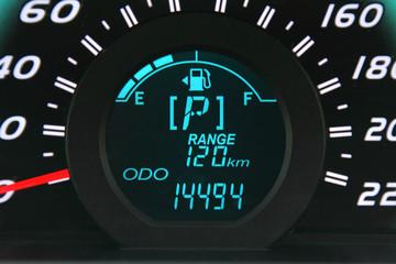 Close-up of a digital car fuel gauge