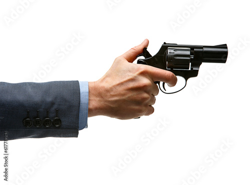 Male hand cocking revolver gun