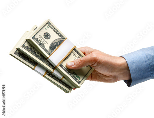 Businessman's hand is giving money