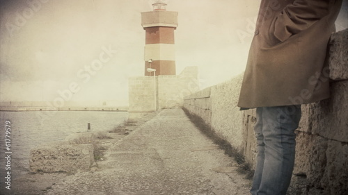 Lighthouse man standing antique