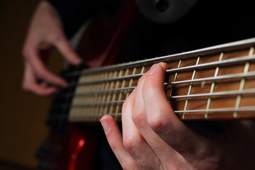 Closeup of guitar and fingers
