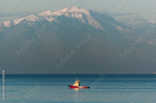 Red tugboat and Mt Olympus, Greece