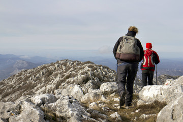 Woman and man climbing ridge of Mosor mountain in Croatia