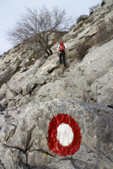 Climber on the hard rocky terrain, mountain Mosor in Croatia