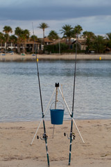 Two fishing rods at the beach in summer