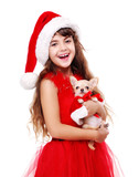 girl in Christmas dress holding the chihuahua puppy