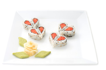 Sushi nicely decorated forming hearts  shapes on white square di