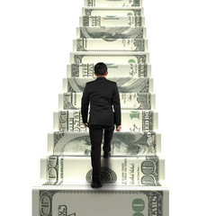 rear view businessman walking on money stairs