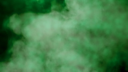 Smoke colorful green on black background