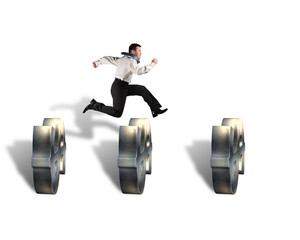 businessman jumping over money symbol obstacles