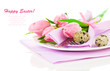 pink tulips with quail eggs in a plate, on a white background. r