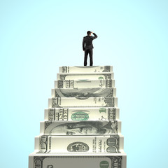businessman gazing on top of money stairs