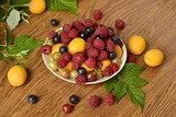 Assortment of berries (raspberries, blue berries, apricots)