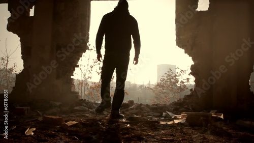 Man Walking Toward Sunlight Abandoned Building Salvation