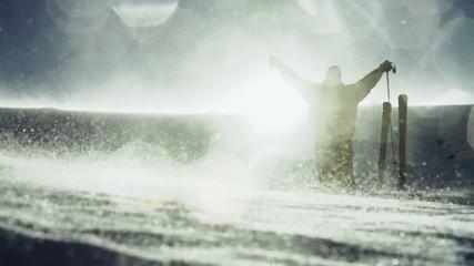 Skier Raising Hands Mountain Top Sun Flare