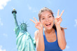 Tourist funny at Statue of Liberty, New York, USA