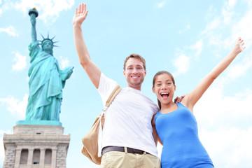 Travel tourists couple at Statue of Liberty, USA