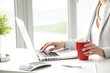 Close-up of businesswoman is typing on her keyboard