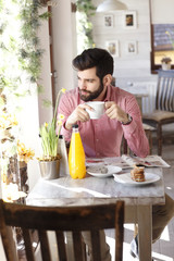 Young man sitting in coffee shop